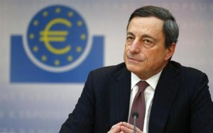 Draghi, President of the ECB, listens to reporter's questions during his monthly news conference in Frankfurt