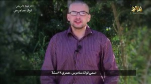 A man, who identified himself as Luke Somers, speaks in this still image taken from video purportedly published by Al Qaeda's Yemen branch
