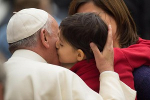 Pope says system causes poverty, not big families