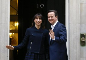 Britain's Prime Minister David Cameron and his wife Samantha return to 10 Downing Street in London