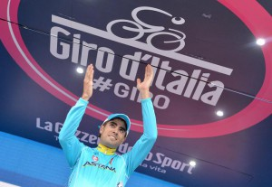 Spanish rider Mikel Landa of the Astana Pro team celebrates on the podium after winning the 15th stage of the 98th Giro d'Italia