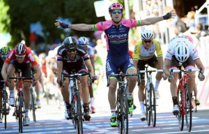 Italian rider Sacha Modolo (C) of Lamre-Merida team celebrates as he crosses the finish line to win the 17th stage of the 98th Giro d'Italia