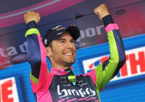 Italian rider Diego Ulissi of Lampre team celebrates on the podium after winning the 8th stage of the 97th Giro d'Italia
