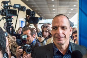 Greece's Finance Minister Yanis Varoufakis arrives for a meeting with EU Commissioner for Economic and Financial Affairs, Taxation and Customs Pierre Moscovici at the European Commission headquarters in Brussels on Tuesday, May. 5, 2015. The European Union on Tuesday nudged up its forecast for economic growth across the 19-country eurozone despite a much gloomier outlook for Greece, which is struggling to get its hands on vital bailout cash that it needs to pay off debts. (ANSA/AP Photo/Geert Vanden Wijngaert)
