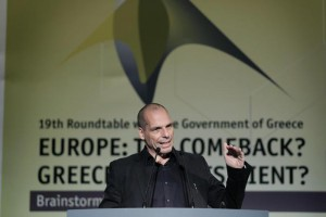 Greek Finance Minister Yanis Varoufakis gives a speech during an economic conference