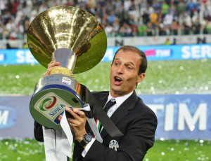 Juventus' coach Massimiliano Allegri celebrates with the trophy of Italian Serie A