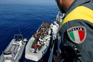 "Personnel of the ship P03 ""Denaro"" of Italian Guardia di Finanza during the transhipment operations of hundreds of migrants"