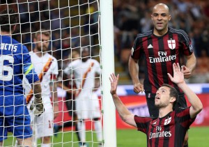 AC Milan's Mattia Destro (down) jubilates after scoring the goal during the Italian Serie A soccer match AC Milan vs AS Roma at Giuseppe Meazza stadium in Milan, Italy, 09 May 2015. ANSA/MATTEO BAZZI