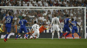 Juventus' Alvaro Morata, second from right, scores during the Champions League second leg semifinal soccer match between Real Madrid and Juventus,