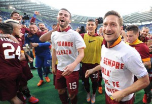 AS Roma's players jubilates after winning Italian Serie A soccer match SS Lazio vs AS Roma