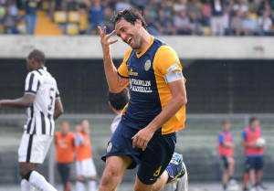 Verona's forward Luca Toni celebrates after scoring the goal of the 1-1 during the Italian Serie A soccer match between Hellas Verona FC and Juventus FC
