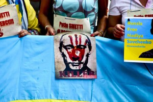 Protesters in Milan denounce Russian president's visit
