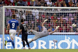 Portugal vs Italy: Portugal's goalkeeper Beto (R) saves a shot by Italy's Ciro Immobile (L)
