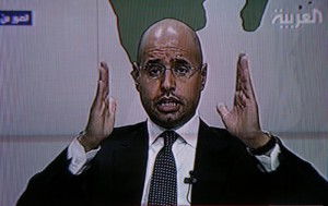 Gaddafi?s son warns of conspiracy as protests continue