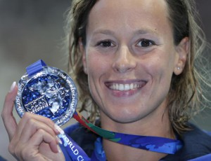 Italy's Federica Pellegrini holds her silver medal after her second place finish in the women's 200m freestyle final at the Swimming World Championships in Kazan, Russia, Wednesday, Aug. 5, 2015. (ANSA/AP Photo/Michael Sohn)