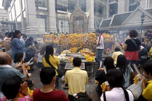 A file photo dated 01 January 2007 showing Thais and tourists gathering to pray for New Year at Erawan shrine at a venue for New Year's countdown at Central World shopping centre in Bangkok, Thailand. Thai police report a major bomb explosion rocked the Erawan Shrine area in downtown Bangkok on 17 August 2015, with at least 12 people reported dead.  EPA/RUNGROJ YONGRIT