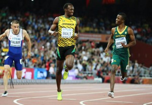 Usain Bolt (L) of Jamaica and Anaso Jobodwana of South Africa cross the line placing 1st and 2nd respectively in their race in the men's 200m semi finals during the Beijing 2015 IAAF World Championships at the National Stadium, also known as Bird's Nest, in Beijing, China, 26 August 2015.  EPA/SRDJAN SUKI