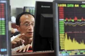 A Chinese stock investor monitors stock prices at a brokerage house in Hangzhou in eastern China's Zhejiang province Tuesday Aug. 25, 2015.  (Chinatopix via AP) CHINA OUT