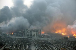 General view of the destruction after explosions in the port area of Tianjin, northern China, 13 August 2015. Official reports say at least 17 people were killed and hundreds injured. Thirty-two people were critically injured, and another 283 in hospital, after the blast and fireball in the port city of Tianjin.  EPA/STR CHINA OUT