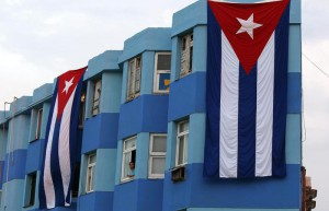 Cuban flags hang from buildings near the US embassy as workers make preparations for the flag hoisting ceremony to be held on 14 August at the arrival of the US Secretary of State John Kerry, in Havana, Cuba, 11 August 2015.  EPA/Alejandro Ernesto