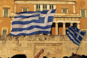 Pro-Euro demonstrators wave Greek flags in front of Greek Parliament during a rally at Syntagma square in Athens, Thursday, July 9, 2015. (ANSA/AP Photo/Emilio Morenatti)