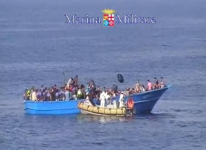 A handout provided on 15 August 2015 and released by the Italian Navy showing migrants on a boat during rescue operation south of Lampedusa island, in the Mediterranean Sea. Italian Navy ships rescued today a boat with almost 400 migrants, 40 of them dead asphyxiated in the hold. ANSA/ US MARINA MILITARE - ITALIAN NAVY PRESS OFFICE