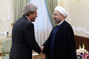 A handout picture made available by the Iranian President's official website on 05 August 2015 shows Iranian president Hassan Rowhani (R) greeting Italian Foreign Minister Paolo Gentiloni (L) at the presidential office in Tehran, Iran, 04 August 2015. Gentiloni arrived 04 August to Tehran for a two-day official visits.  EPA/PRESIDENTIAL OFFICIAL WEBSITE