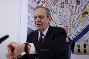 Italian Finance Minister Pier Carlo Padoan checks his watch prior to the start of a press conference at the Foreign Press club, in Rome, Tuesday, Aug. 4, 2015. (ANSA/AP Photo/Gregorio Borgia)