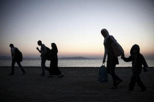 Migrants walk along a beach on the Greek southeastern island of Kos, Wednesday, Aug. 12, 2015. (ANSA/AP Photo/Yorgos Karahalis)