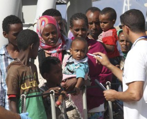 Migrants disembark from the Swedish Fire Fighting Vessel KVB 001 POSEIDON, at the Reggio Calabria harbor, Southern Italy, Wednesday, Aug. 12, 2015. Some 417 migrants were rescued in the Mediterranean Sea and taken to Reggio Calabria. (ANSA/AP Photo/Adriana Sapone)