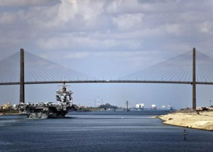 A picture made available by the US NAVY on 15 October shows The aircraft carrier USS Enterprise (CVN 65) crosses under the Friendship Bridge in the Suez Canal