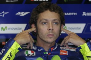 Yamaha rider Valentino Rossi from Italy adjusts his ear plugs during the third MotoGP third practice at the Masaryk circuit in Brno, Czech Republic, Saturday, Aug. 15, 2015. The Motorcycle Grand Prix of the Czech Republic is scheduled for Sunday Aug. 16, 2015. (ANSA/AP Photo/Petr David Josek)