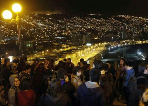 A group of people who left their houses in Valparaiso, Chile, late 16 September 2015, after a tsunami alert was issued for the earthquake of 8.3 on the Richter scale. A strong earthquake of magnitude 8.3 rattled Chilean capital Santiago and other regions of the country the US Geological Service reported. There were no immediate reports of casualties, and coastal areas around Chile were being evacuated for fear of a tsunami. First waves have reached the shore.  EPA/RAUL ZAMORA