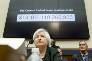 US Federal Reserve Board Chairwoman Janet Yellen sits in front of a monitor counting the current US national debt, while appearing at the House Financial Services Committee hearing on 'Monetary Policy and the State of the Economy', on Capitol Hill in Washington DC, USA, 15 July 2015.      ANSA  /MICHAEL REYNOLDS