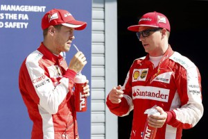 German Formula One driver Sebastian Vettel (L) of Scuderia Ferrari and his teammate Finnish Formula One driver Kimi Raikkonen greet the audience at the end of the qualifying session at the Italian Formula One circuit in Monza, Italy, 5 September 2015. British Formula One driver Lewis Hamilton (not pictured) of Mercedes AMG GP took the pole position ahead of Raikkonen and Vettel. The 2015 Formula One Grand Prix of Italy will take place on 6 September 2015.  EPA/SRDJAN SUKI