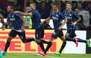Inter's miedfielder Freddy Guarin celebrates with his teammates after scoring the first goal of the Italian Serie A soccer match between FC Inter and AC Milan at Giuseppe Meazza Stadium in Milan, 13 Settembre 2015. ANSA/ BAZZI