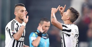 Paulo Dybala of Juventus (R) celebrates after scoring a penalty against Chievo during Italian Serie A soccer match at the Juventus Stadium between Juventus and Chievo, Turin, 12 September 2015. ANSA/DI MARCO