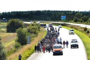 Migrants, mainly from Syria and Iraq, seen walking at the E45 freeway from Padborg in South of Jutland heading north to try to get to Sweden, 09 September 2015. EPA/CLAUS FISKER DENMARK OUT