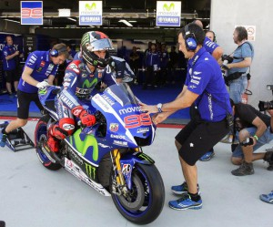 Spanish MotoGP rider Jorge Lorenzo (C) of the Movistar Yamaha team leaves his team's garage during the free training session at Motorland circuit in Alcaniz, Spain, 25 September 2015. EPA/JAVIER CEBOLLADA