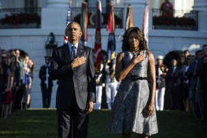 US President Barack Obama (L) and First Lady Michelle Obama (R) walk onto the South Lawn prior to a moment of silence in memory of those lost in the 9/11 terror attacks, at the White House in Washington, DC, USA 11 September 2015.  EPA/JIM LO SCALZO