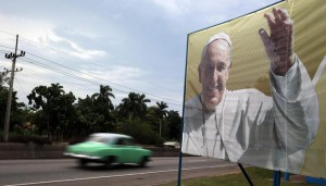 A vintage cars rushes by a billboard with the portrait of Pope Francis in Havana, Cuba, 18 September 2015, on the eve of the upcoming visit of the Pope to the island. Pope Francis will visit Cuba from 19 to 22 September 2015.  EPA/ALEJANDRO ERNESTO