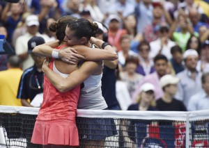 Flavia Pennetta of Italy (R) embraces Roberta Vinci of Italy at the net after the women's final on the thirteenth day of the 2015 US Open Tennis Championship at the USTA National Tennis Center in Flushing Meadows, New York, USA, 12 September 2015. The US Open runs through 13 September, which is a return to a 14-day schedule.  EPA/JUSTIN LANE