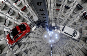 FILE - In this March 12, 2012, file photo, a Volkswagen New Beetle is lifted inside a delivery tower after the company's annual press conference in Wolfsburg, Germany. Volkswagen CEO Martin Winterkorn promised full cooperation with the government following the company's admission it rigged nearly a half million cars to defeat U.S. smog tests.  (ANSA/AP Photo/Michael Sohn, File)