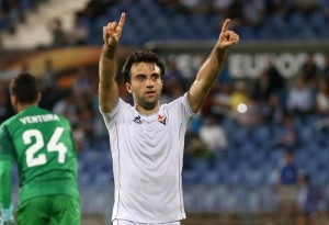 Fiorentina's Giuseppe Rossi celebrates after scoring his sides fourth goal during the Europa League group I soccer match between Belenenses and Fiorentina at the Restelo stadium in Lisbon, Thursday, Oct. 1 2015. (ANSA/AP Photo/Armando Franca)