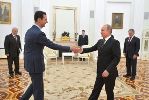 A picture made available on 21 October 2015 shows Russian President Vladimir Putin (R) shaking hands with Syrian President Bashar al-Assad during their meeting at the Kremlin in Moscow, Russia, 20 October 2015. EPA/ALEXEY DRUZHINYN/RIA NOVOSTI/POOL