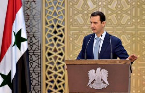 A handout photo released by the official Syrian Arab News Agency (SANA) shows Syrian President Bashar al-Assad delivering a speech during a meeting with heads and members of public organizations, vocational syndicates, and chambers of industry, trade, agriculture and tourism in Damascus, Syria, 26 July 2015.
