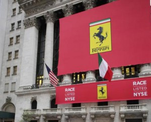 the facade of the New York Stock Exchange prior to Ferrari's IPO, Wednesday, Oct. 21, 2015. The parent company, mass-market carmaker Fiat Chrysler Automobiles, is selling shares under the stock name RACE. (ANSA/AP Photo/Mark Lennihan)