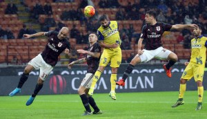 Chievo Verona's forward Sergio Pellissier Jumps for the ball with Ac Milan midfielder Juraj Kucka during the Italian Serie A soccer match between AC Milan and Chievo Verona  at Giuseppe Meazza stadium in Milan, 28 october 2015. ANSA / MATTEO BAZZI