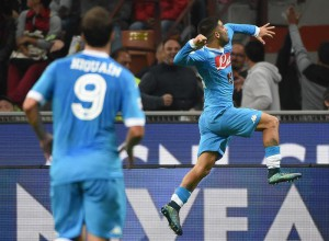 Napolis' forward Lorenzo Insigne celebrates after scoring the 3-0 lead during the Serie A soccer match between AC Milan and Napoli at the Giuseppe Meazza stadium in Milan, Italy, 4 October 2015. ANSA/DANIEL DAL ZENNARO