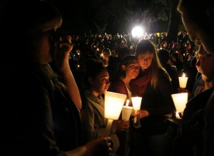 Community members attend a candlelight vigil at Stewart Park for those killed during a shooting at Umpqua Community College in Roseburg, Ore., Thursday, Oct. 1, 2015. (ANSA/AP Photo/Gosia Wozniacka)